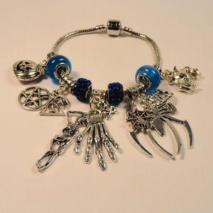 Jewelry - Blue Charm Bracelet 13 Skeleton Skulls Spiders Bat